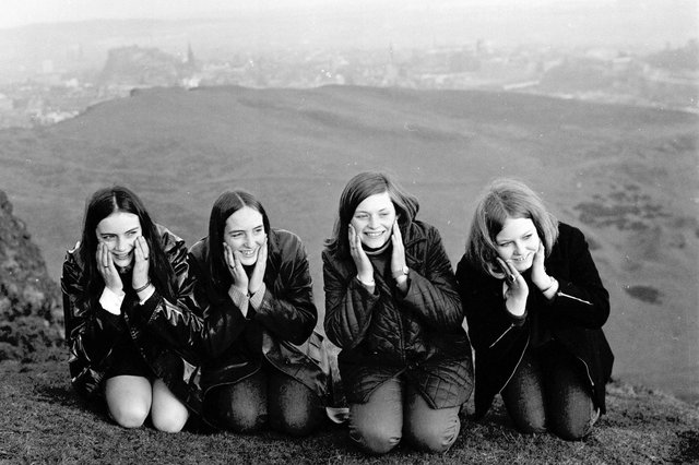Four girls wash their faces in the dew at the top of Arthur's Seat Edinburgh on May Day 1969