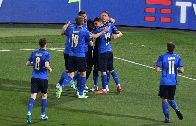 Ciro Immobile celebrates with his team-mates after giving Italy the lead. Picture: Getty