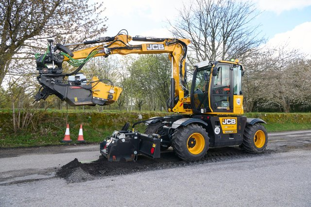 JCB's PotholePro machine in action in Alness today. Picture: JCB