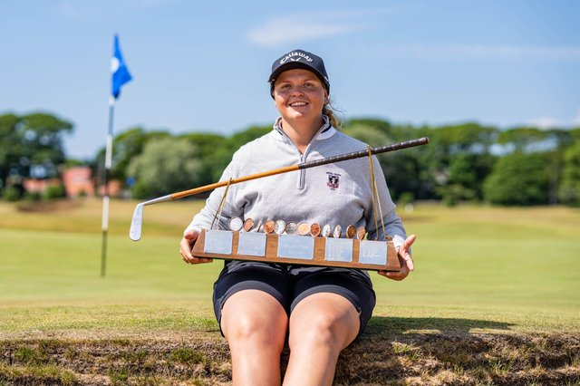 Australian Kirsten Rudgeley shows off the Helen Holm Scottish Women's Open Trophy after her win at Royal Troon Portland Course. Picture: Scottish Golf.