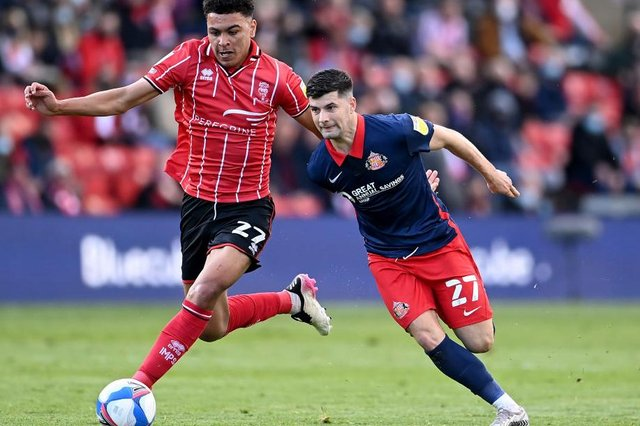 Jordan Jones of Sunderland battles for possession with Morgan Rogers of Lincoln City  during the Sky Bet League One Play-off Semi Final 1st Leg match between Lincoln City and Sunderland. (Photo by Laurence Griffiths/Getty Images)