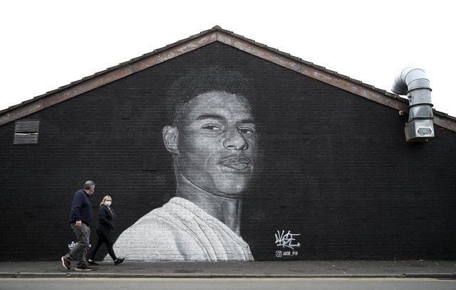 A mural of Manchester United striker Marcus Rashford by Street artist Akse on the wall of the Coffee House Cafe on Copson Street, Withington.