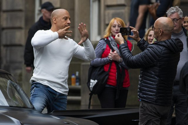 Vin Diesel, with director Justin Lin, on Edinburgh's Royal Mile filming the Fast and Furious sequel F9 - which has had its release date delayed. Picture: Lisa Ferguson/JPIMedia.