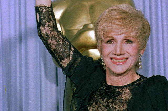 """Olympia Dukakis has died aged 89. she can be seen her in 1988 holding her Oscar for best supporting actress for her role in """"Moonstrck."""" (AP Photo/Lennox Mcleondon)"""