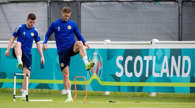 Leeds United defender Liam Cooper (right) pictured during a Scotland training session at Rockliffe Park. (Photo by Ross Parker / SNS Group)