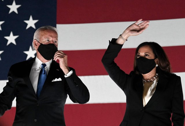 Joe Biden, seen with Vice-President Kamala Harris, has promised the US power sector will produce net-zero carbon emissions by 2035 (Picture: Olivier Douliery/AFP via Getty Images)