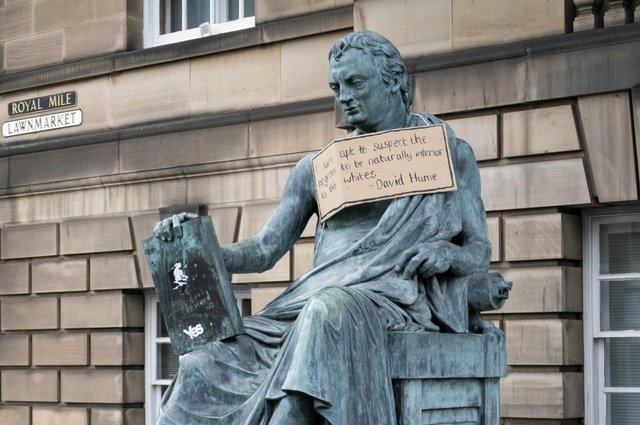A poster hangs from the statue of the 18th Century philosopher David Hume on Edinburgh's Royal Mile, following a Black Lives Matter protest rally in June (Picture: Jane Barlow/PA)