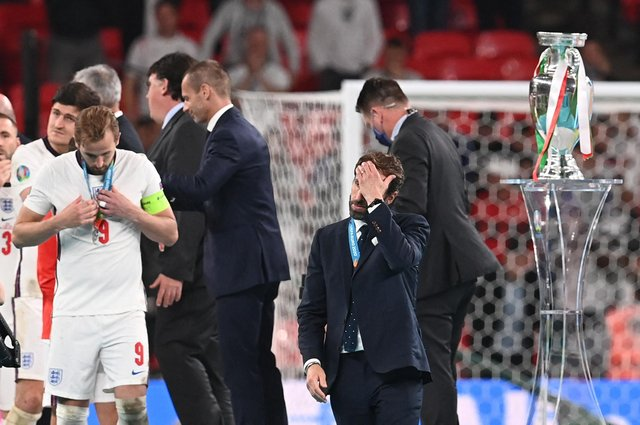 England manager Gareth Southgate walks past the European Championship trophy after losing the final on penalties to Italy (Photo by PAUL ELLIS/POOL/AFP via Getty Images)