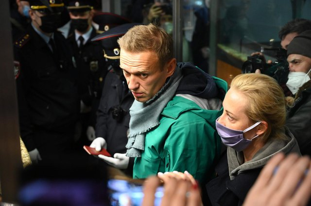 Russian police detained Kremlin critic Alexei Navalny at a Moscow airport shortly after he landed on a flight from Berlin