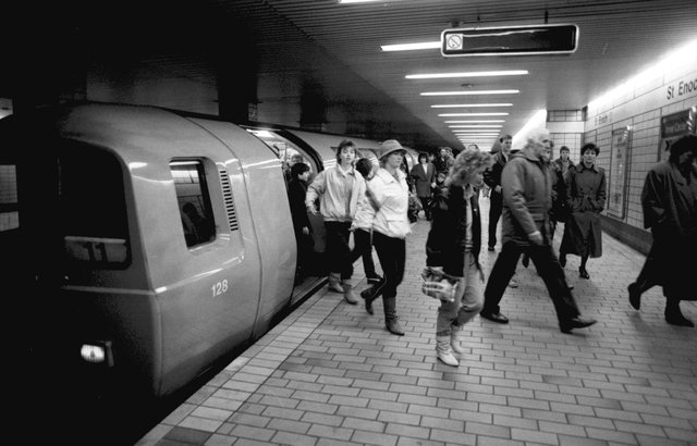 Passengers leaving the subway train at St Enboch underground station in Glasgow, December 1986.