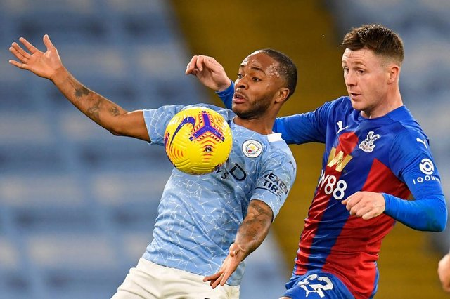 James McCarthy keeps a close eye on Manchester City forward Raheem Sterling