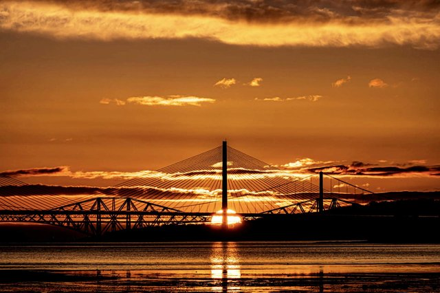 52 year-old Martin Brown captured the sun rising over the Queensferry Crossing, the Forth Road Bridge and the 'iconic' Forth Rail Bridge this morning (Photo: Martin Brown).