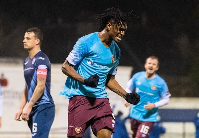 Armand Gnanduillet celebrates a great debut for Hearts. (Photo by Ross Parker / SNS Group)