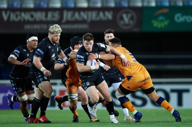 Huw Jones of Glasgow Warriors is tackled by Montpellier's Mohamed Haouas. Picture: Alex Caparros/Getty Images for EPCR