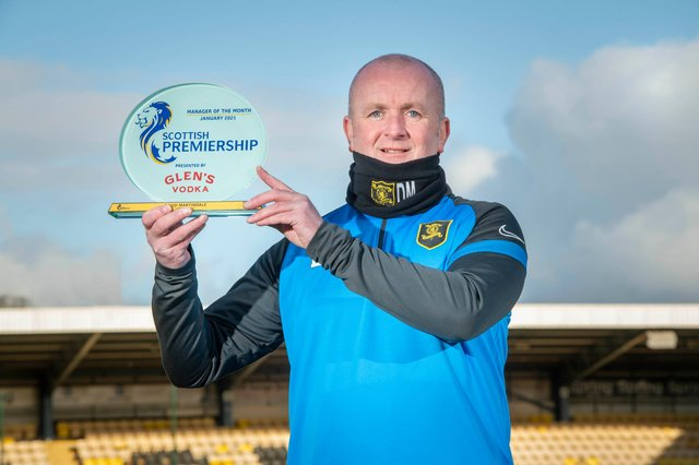 Livingston boss David Martindale with his January manager of the month award. Picture: Paul Chappells