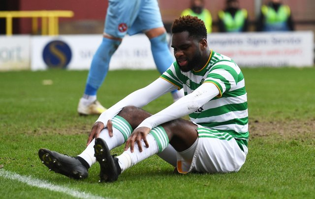 A frustrated Odsonne Edouard sits on the Tannadice pitch as Celtic draw with Dundee United. Picture: SNS