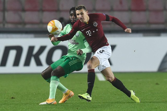 Celtic's scorer Odsonne Edouard , one of the few bright sport in the grim 4-1 defeat in Prague, is challenged by Sparta defender Dominik Plechaty (Photo by Michal Cizek / AFP) (Photo by MICHAL CIZEK/AFP via Getty Images)