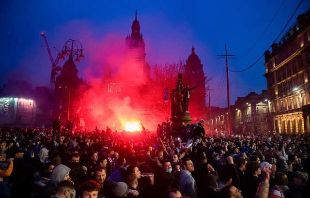 Rangers fans in George Square celebrating their team's title win on Sunday. Picture: SNS