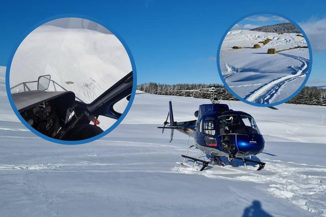 Murray Graham used his helicopter to help farmers deliver food to their sheep in the snow picture: Murray Graham