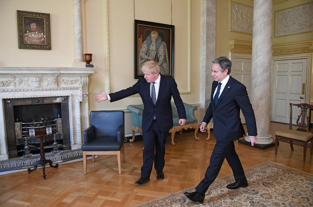 Boris Johnson ushers US Secretary of State Antony Blinken to his seat inside 10 Downing Street. A trade deal with the US is foreign policy imperative for Brexit Britain (Picture: Stefan Rousseau/PA)