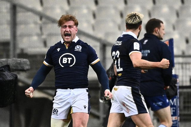 Stuart Hogg roars with delight after Duhan van der Merwe's late try gave Scotland a first win in Paris since 1999