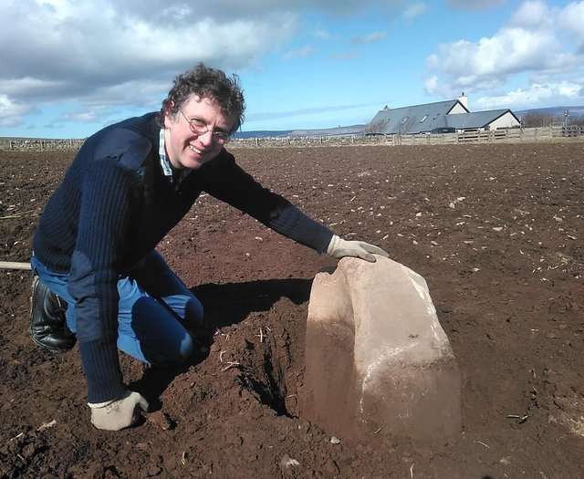 Chris Gee of the Archaeology Institute at University of Highlands and Islands with the quernstone, which was used to grind corn. The find adds more evidence to the belief that a settlement could have been made here between 3600-3200BC, hundreds of years before the world-famous Skara Brae. PIC: UHI Archaeology Institute.