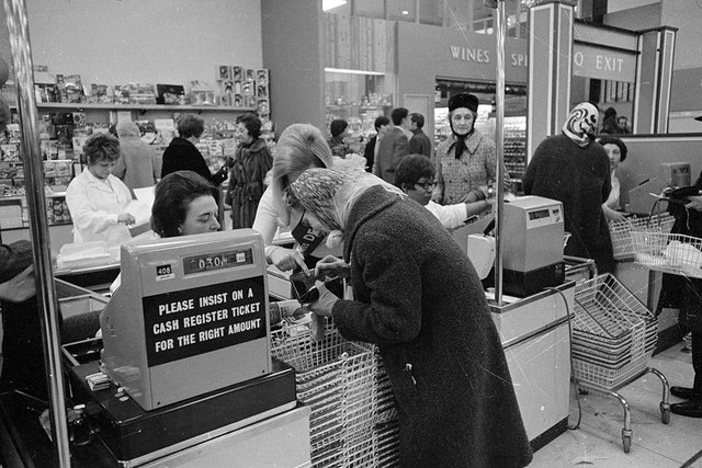 An assistant helps an elderly customer pay for her purchases using the new decimal coinage in a London supermarket on the first day of national decimalisation (Photo: Leonard Burt/Central Press/Getty Images)