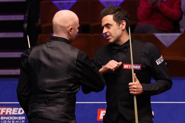 Ronnie O'Sullivan (right) bumps elbows with Anthony McGill after the Scot's victory at the Betfred World Snooker Championships at the Crucible. Picture: George Wood/PA Wire