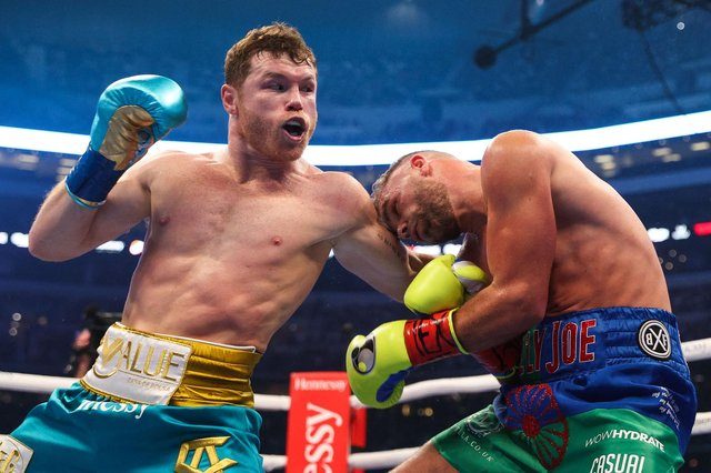 """Mexico's Saul """"Canelo"""" Alvarez, left, connects with Billy Joe Saunders during their super middleweight title fight at the AT&T Stadium in Arlington, Texas. Picture: Ed Mulholland/Matchroom Boxing/AFP via Getty Images"""