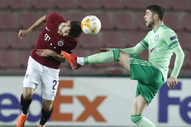 Ryan Christie battles for possession with Sparta's Michal Travnik. Picture: AP