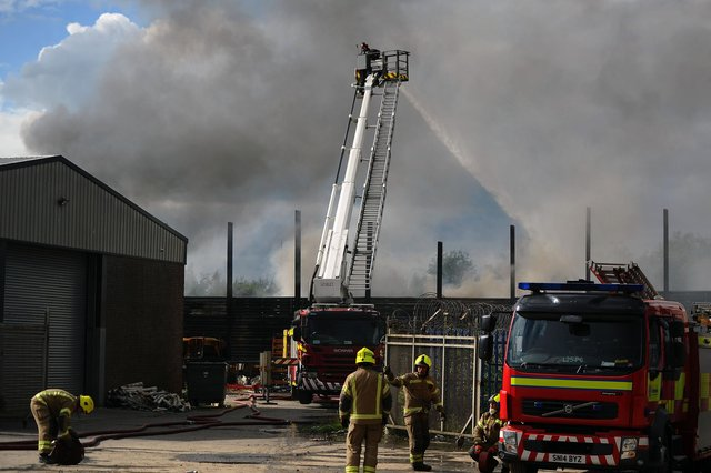 Firefighters tackle  a blaze in scrap yard at Angus Braidwood and Son Ltd on Castle Drive, Falkirk. (Pic: Michael Gillen)