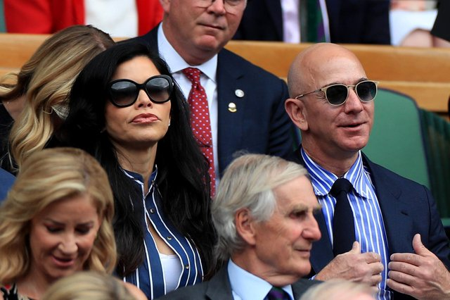 Amazon founder Jeff Bezos, seen wearing sunglasses at Wimbledon in 2019, is the world's richest person (Picture: Mike Egerton/PA Wire)