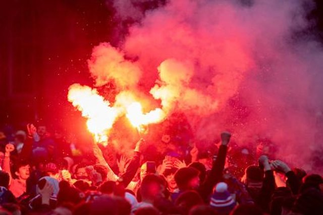 Rangers fans lined the Clyde with flares on Friday night - but have been warned over similar scenes to the Edmiston Drive and George Square gatherings (above) that marked winning their title in March. (Photo by Craig Foy / SNS Group)