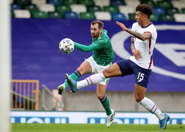 Northern Ireland's midfielder Niall McGinn (L) shoots to score their first goal during the international friendly football match between Northern Ireland and the United States at Windsor Park in Belfast on March 28, 2021. - USA won the game 2-1. (Photo by PAUL FAITH/AFP via Getty Images)