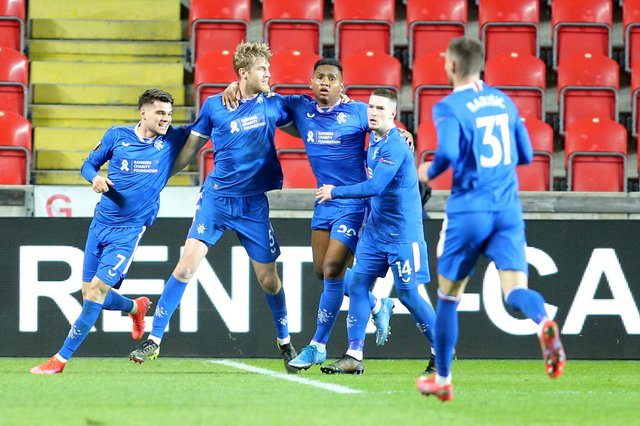 Rangers players celebrate Filip Helander's equaliser in the 1-1 draw against Slavia Prague in the first leg of their Europa League round of 16 tie. (Photo by MILAN KAMMERMAYER/AFP via Getty Images)