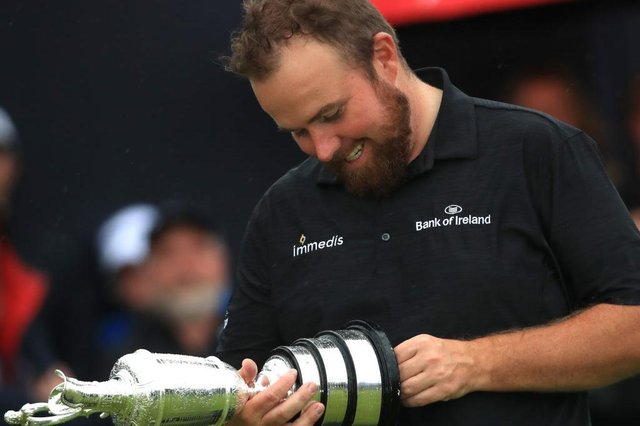 Shane Lowry gazes at the Claret Jug after his win the 148th Open at Royal Portrush in 2019. Picture: Andrew Redington/Getty Images.