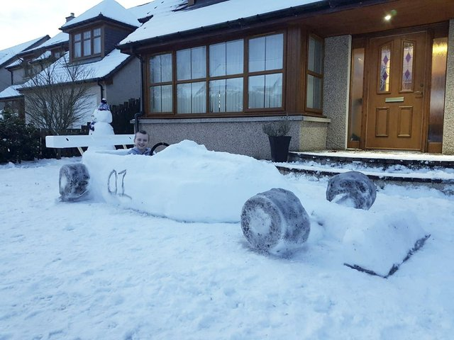 Brody Penny in the racing car made from snow.