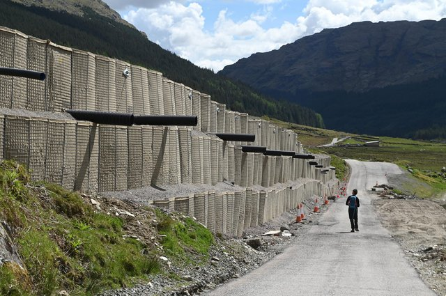 The 20ft high bund protecting the Old Military Road below the A83. Picture: John Devlin