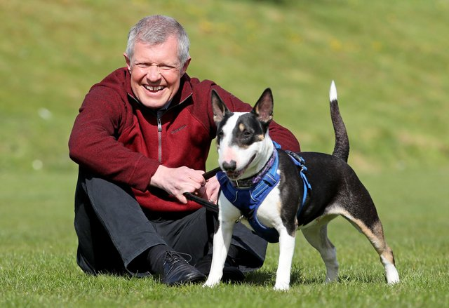 Scottish Liberal Democrat leader Willie Rennie meets Daisy an English bull terrier during a visit to the Edinburgh Dog and Cat Home while campaigning for the Scottish Parliamentary election.