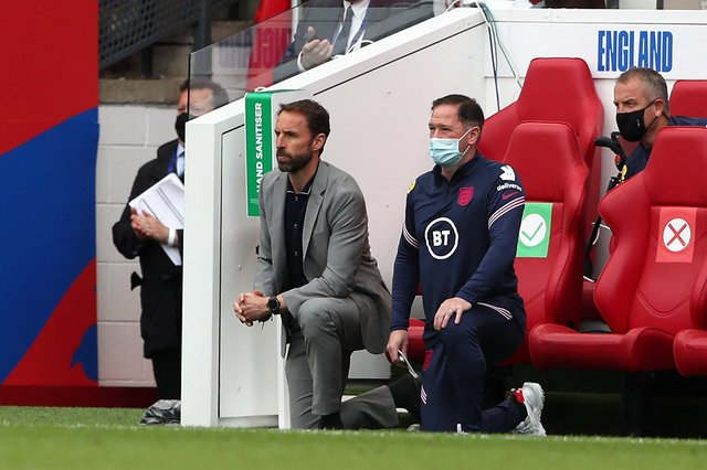 England's manager Gareth Southgate and  Steve Holland, assistant coach of England, 'take a knee'. Picture: Getty Images