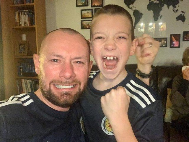 iain Meiklejohn and his son Aleks after the full-time whistle when Scotland beat Serbia on penalties to qualify for Euro 2020
