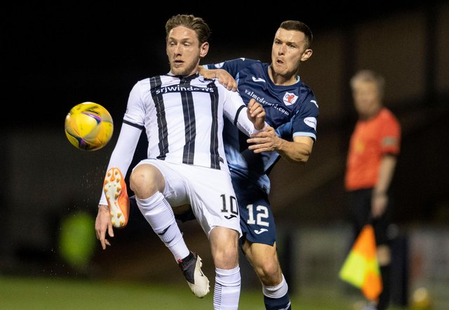 Dunfermline's Declan McManus (left) holds off Raith's Ross Matthews during the recent league meeting between the sides, which Raith won 5-1. (Photo by Ross Parker / SNS Group)