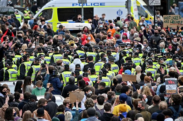 Two men detained by the Home Office are released after protestors blocked the immigration van from leaving Kenmure Street.