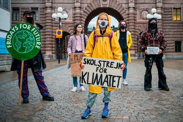 """Swedish climate activist Greta Thunberg protests with demonstrators during a """"Fridays for Future"""" protest in front of the Swedish Parliament Riksdagen in Stockholm on October 9, 2020."""