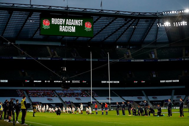 Some players stand and others take the knee ahead of the England v Scotland Six Nations match at Twickenham. Picture: Adrian Dennis/AFP via Getty Images