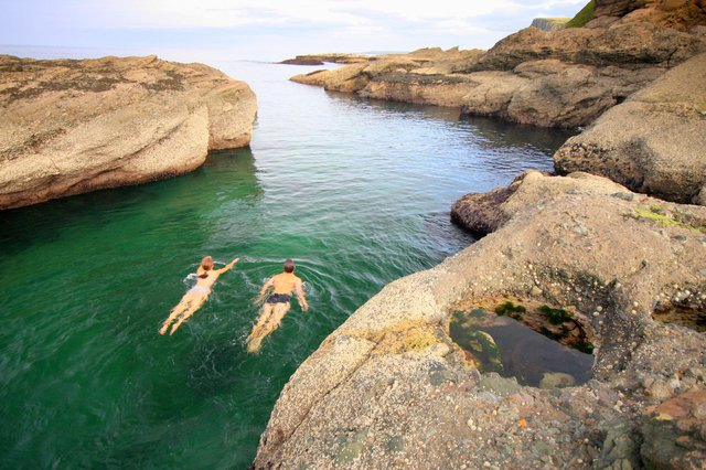 Hell's Lum at Pennan, Aberdeenshire, offers swimmers a dramatic network of caves, pools and beaches.