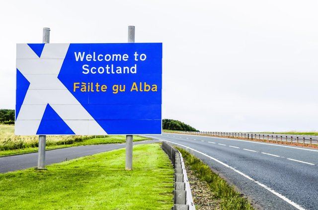 A Welcome to Scotland road sign at the Scotland/England border on the A1