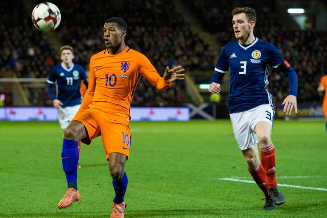 Georginio Wijnaldum in action against Andrew Robertson during a friendly between Scotland and the Netherlands at Pittodrie in November 2017. Picture: SNS