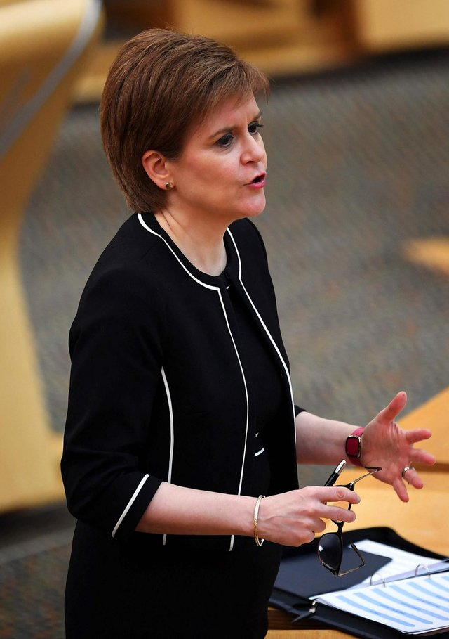 Scotland's First Minister Nicola Sturgeon attends a session at the Scottish Parliament where she delivered an update on the Covid-19 pandemic, in Holyrood, Edinburgh on March 9, 2021. (Photo by Andy Buchanan / POOL / AFP).