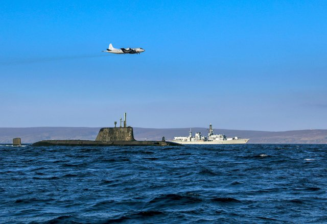 From the Joint Warrior biannual NATO exercise. An Astute class nuclear submarine in company with the Type 23 frigate HMS Kent being over flown by a German Navy P3 maritime patrol aircraft. Pic: Jim Gibson/ Royal Navy